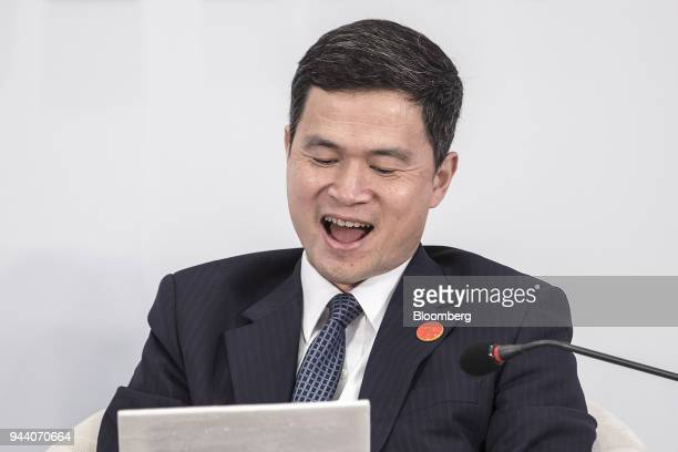 Fang Xinghai vice chairman of the China Securities Regulatory Commission writes in a notepad during a session at the Boao Forum for Asia Annual...