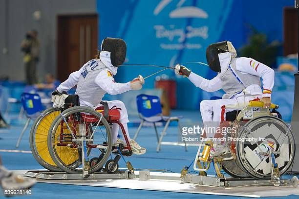 Fang Yao of China against Gema Victoria Hassen of Spain in women's individual epee preliminary rounds at the Paralympics