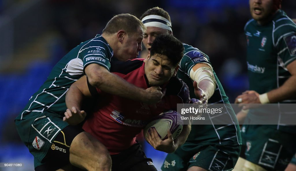 Fangatapu Apikotoa of Krasny Yar is tackled by David Paice of London Irish during the European Rugby Challenge Cup between London Irish and Krasny Yar on January 13, 2018 in Reading, United Kingdom.