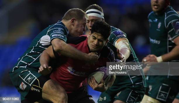 Fangatapu Apikotoa of Krasny Yar is tackled by David Paice of London Irish during the European Rugby Challenge Cup between London Irish and Krasny...
