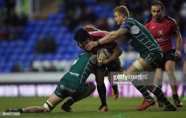 Fangatapu Apikotoa of Krasny Yar is tackled by Jack Cooke of London Irish during the European Rugby Challenge Cup between London Irish and Krasny Yar...