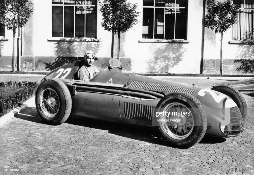 Fangio in Alfa Romeo, prior to the San Remo Grand Prix, Italy, 1950. Juan Manuel Fangio won the race, his first at the wheel of an Alfa Romeo. In his Formula 1 career between 1950 and 1958, Fangio won a then record 24 Grands Prix, driving for Alfa Romeo, Maserati and Ferrari and won the World Drivers' Championship in 1951, 1954, 1955, 1956 and 1957, a record which remains unequalled. The most remarkable aspect of Fangio's record is that these successes came from a career which only lasted for 51 races.