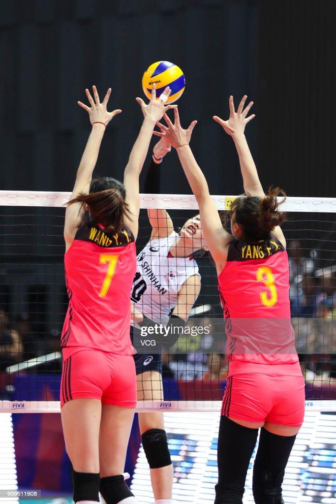 Fangxu Yang #3 and Yuanyuan Wang #7 of China defend against Yeon Koung Kim #10 of South Korea during the FIVB Volleyball Nations League 2018 at Beilun Gymnasium on May 17, 2018 in Ningbo, China.