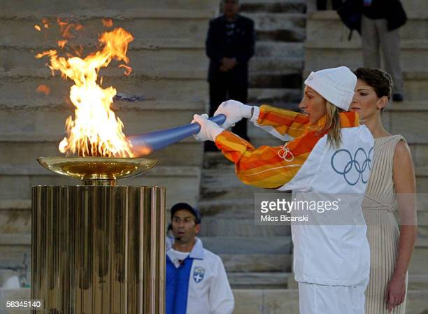 Fani Halkia of Greece Athens Olympic gold medalist in the women's 400meter hurdles lights a cauldron with the flame for the Turin 2006 Winter Games...