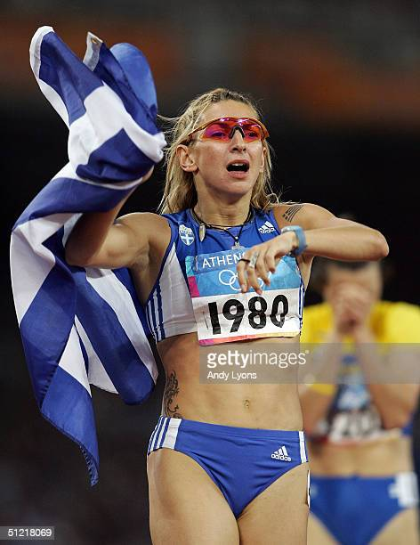 Fani Halkia of Greece celebrates after she won gold in the women's 400 metre hurdle final on August 25 2004 during the Athens 2004 Summer Olympic...