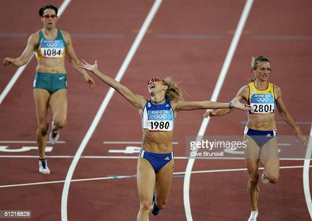 Fani Halkia of Greece celebrates infront of Jana Pittman of Australia and after she won gold in the women's 400 metre hurdle final on August 25 2004...