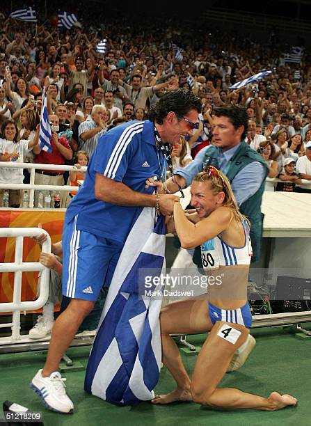Fani Halkia of Greece celebrates she won gold in the women's 400 metre hurdle final on August 25 2004 during the Athens 2004 Summer Olympic Games at...