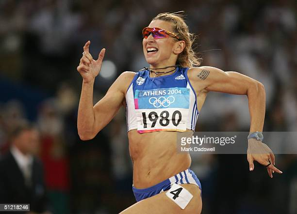 Fani Halkia of Greece compete in the women's 400 metre hurdle final on August 25 2004 during the Athens 2004 Summer Olympic Games at the Olympic...