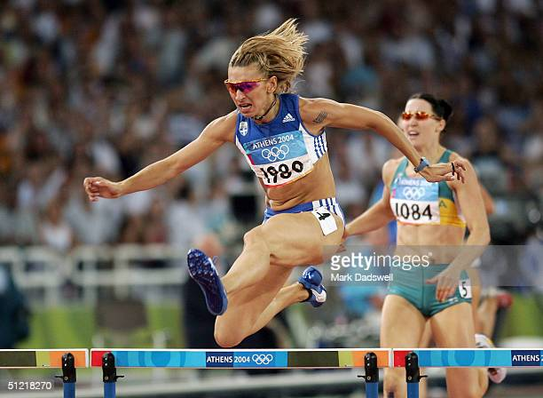 Fani Halkia of Greece competes next to Jana Pittman of Australia in the women's 400 metre hurdle final on August 25 2004 during the Athens 2004...