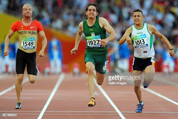 Fanie van der Merwe of South Africa celebrates wins gold in the 100m T37 during day 6 of the 2008 Beijing Paralympic Games September 12 2008 in...