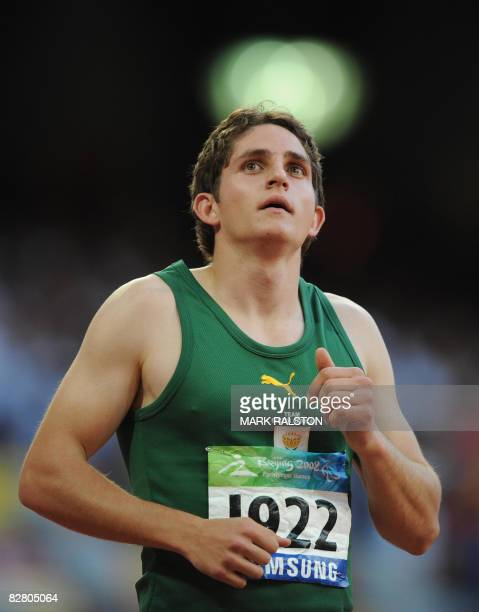 Fanie van der Merwe of South Africa checks his time after winning the final of the men's 100 metre T37 classification event at the 2008 Beijing...
