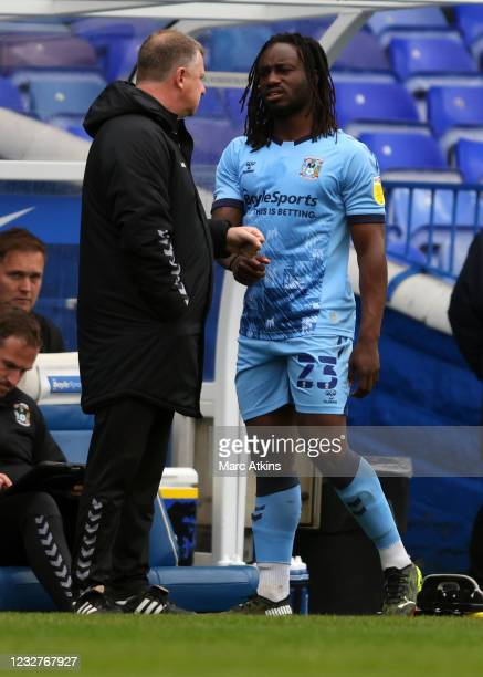 Fankaty Dabo of Coventry City speaks with Coventry City manager Mark Robins during the Sky Bet Championship match between Coventry City and Millwall...
