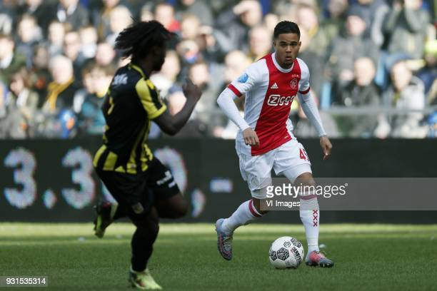 Fankaty Dabo of Vitesse Justin Kluivert of Ajax during the Dutch Eredivisie match between Vitesse Arnhem and Ajax Amsterdam at Gelredome on March 04...