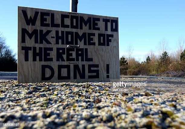 Fan-made sign sits on a roadside ahead of the FA Cup Second Round match between MK Dons and AFC Wimbledon at Stadium MK on December 2, 2012 in Milton...