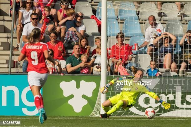 Fanndis Fridiksdottir of Iceland women scores AnaMaria Crnogorcevic of Switzerland women goalkeeper Gaelle Thalmann of Switzerland women during the...