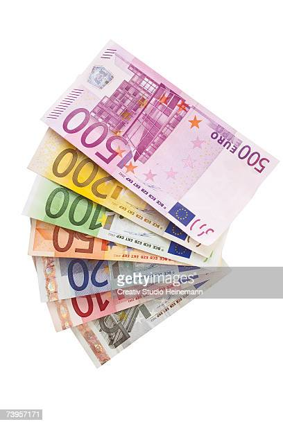 fanned euro notes - five euro banknote stock photos and pictures