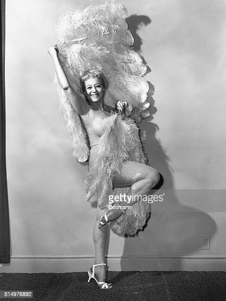 Sally Rand who still looks about as glamorous as when she first gained fame with her fan dance in 1933 strikes a classic pose with her fans during an...