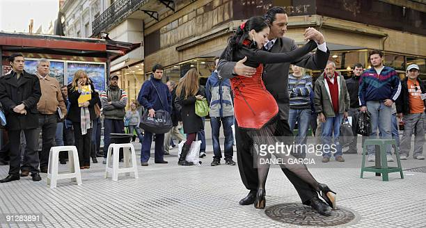 Fanny and Fabio a couple of tango street dancers perform in the intersection of Florida and Lavalle streets in downtown Buenos Aires on September 30...