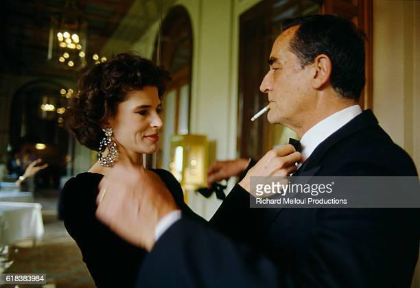 Fanny Ardant and Vittorio Gassman get ready for a reception during the Cannes Film Festival
