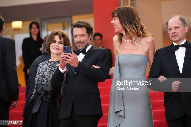 Fanny Ardant Nicolas Bedos photographs Doria Tillier during the screening of La Belle Epoque during the 72nd annual Cannes Film Festival on May 20...