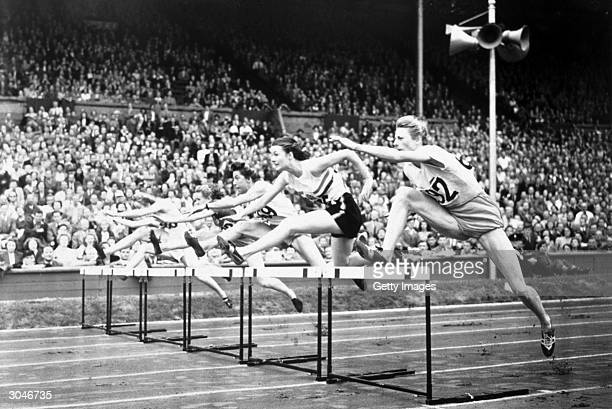 Fanny BlankersKoen far right of the Netherlands competes during the XIV Olympic Games Circa August of 1948 in London England