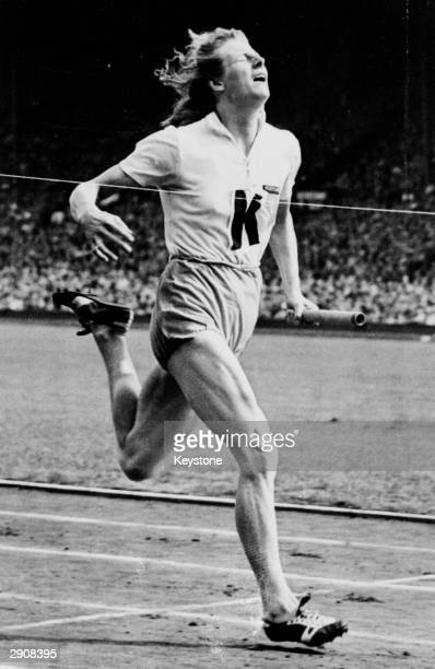 Fanny Blankers-Koen of the Netherlands in action on the anchor leg of the 4 x 100 metres relay during the 1948 Olympic Games at Wembley Stadium,...