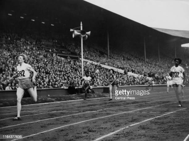 Fanny Blankers-Koen of the Netherlands wins heat 1 of the semi-finals of the Women's 200 Metre event at the Empire Stadium, Wembley, London, during...