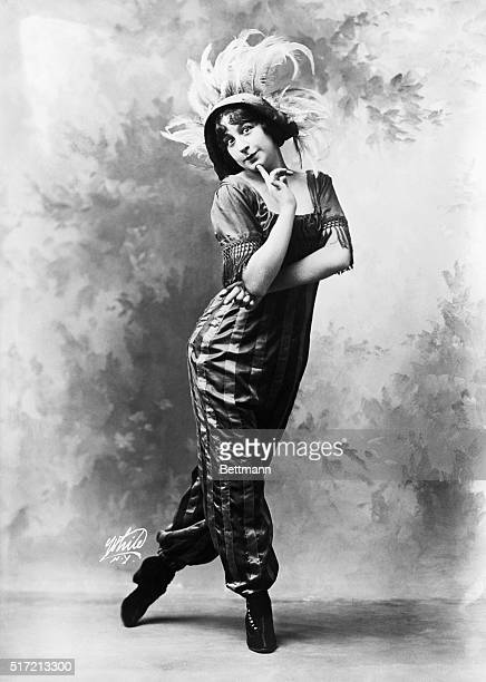 Fanny Brice headlined in Ziegfeld Follies 1911 Depicted alone posed with arm crossed and finger on chin wearing a feather hat