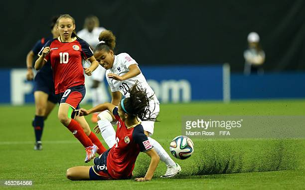 Fanny Hoarau of France and Fabiola Villalobos of Costa Rica battle for the ball during the FIFA U20 Women's World Cup 2014 group D match between...