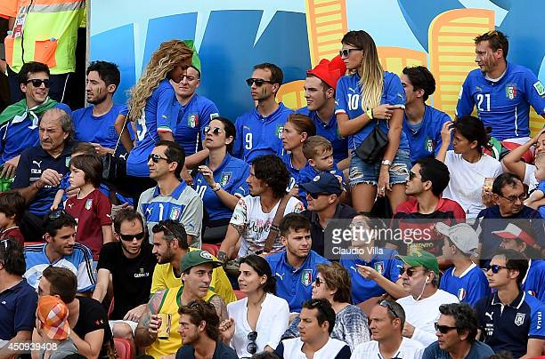 Fanny Neguesha fiancee of Mario Balotelli of Italy and Carolina Marcialis wife of Antonio Cassano of Italy look on during the 2014 FIFA World Cup...