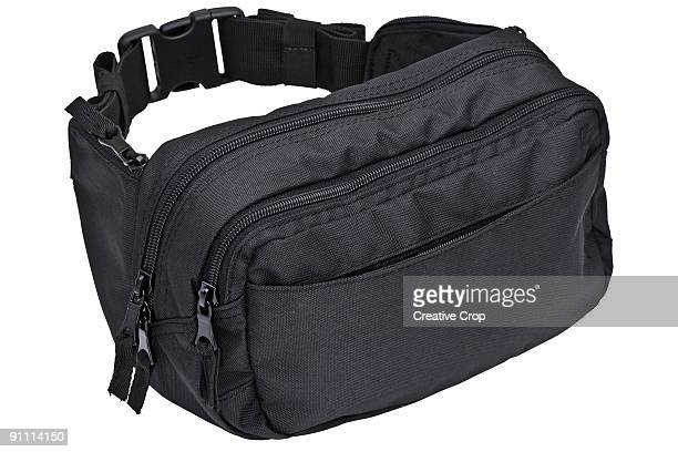 fanny pack / bum bag - waist pack stock pictures, royalty-free photos & images