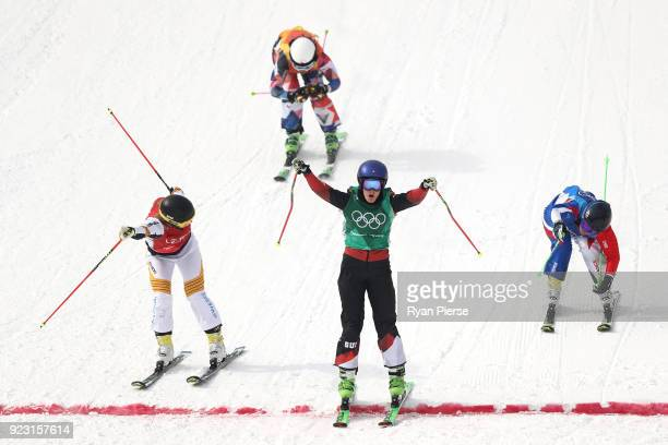 Fanny Smith of Switzerland celebrates as she crosses the line from Sandra Naeslund of Sweden and Marielle Berger Sabbatel of France during the...