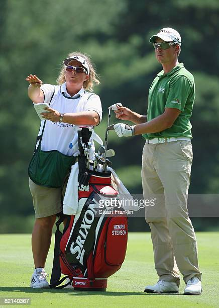 Fanny Suneson gives directions to Henrik Stenson of Sweden on the nineth hole during first round of the World Golf Championship Bridgestone...