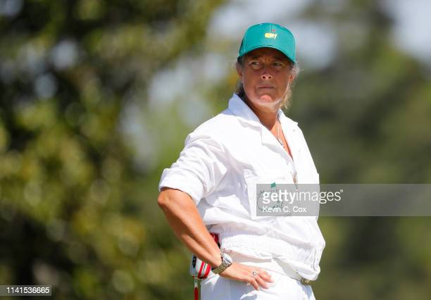 Fanny Sunesson caddie for Henrik Stenson of Sweden looks on during a practice round prior to the Masters at Augusta National Golf Club on April 09...