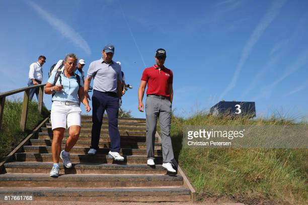 Fanny Sunesson Sir Nick Faldo of England and Henrik Stenson of Sweden walk off the 3rd tee during a practice round prior to the 146th Open...