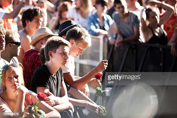 Fanpay their respect during the performance of American rock legend Patti Smith in Roskilde on July 1 2010 in memory of the nine people who passed...