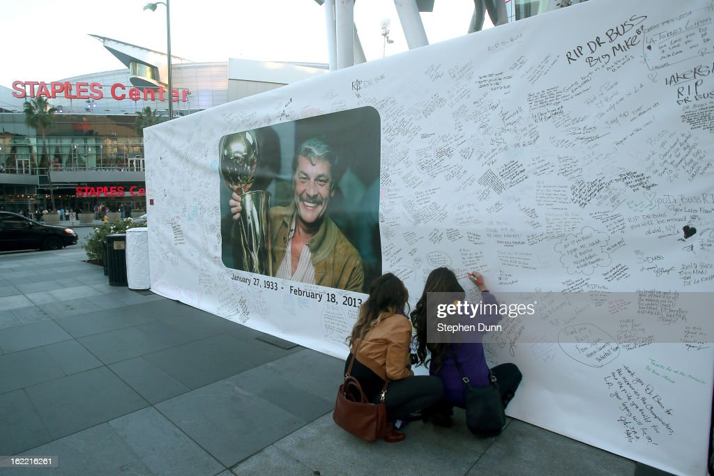 Fans adds their wishes to a wall near Staples Center in honor of the late Dr. Jerry Buss, owner of the Los Angeles Lakers, before the game against the Boston Celtics on February 20, 2013 in Los Angeles, California.