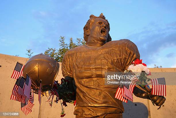 Fans adorn the Pat Tillman statue with American flags in honor of the 10 year anniversary of the 9/11 attacks following the NFL season opening game...