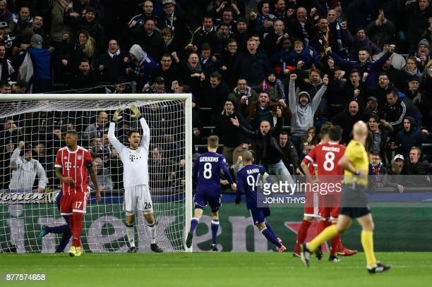 Fans and Bayern Munich's players react after Anderlecht's Algerian midfielder Sofiane Hanni scored a goal during the UEFA Champions League Group B...