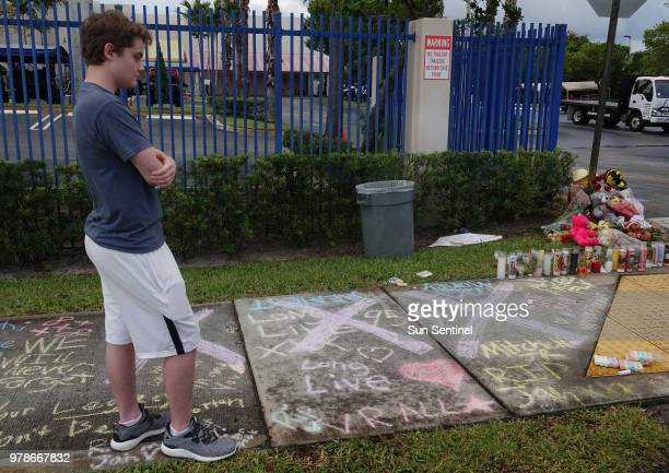 Fans and mourners of Browardbased rapper XXXTentacion whose given name was Jahseh Onfroy visit the shooting scene on Tuesday June 19 outside Riva...