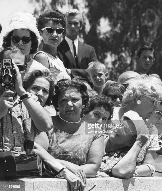 Fans and onlookers gather outside the Westwood Village Memorial Park Cemetery for the internment of recently deceased American actress Marilyn Monroe...