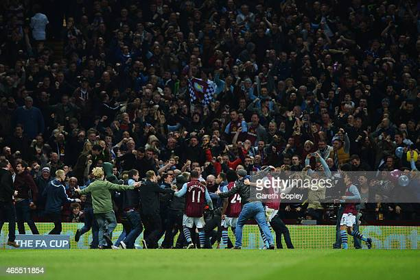 Fans and players celebrate as Scott Sinclair of Aston Villa scores their second goal during the FA Cup Quarter Final match between Aston Villa and...