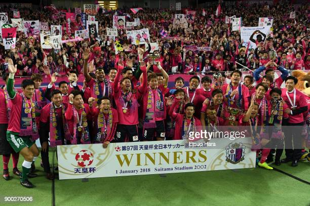 Fans and players of Cerezo Osaka celebrate their victory as captain Yoichiro Kakitani lifts the trophy after the 97th All Japan Football Championship...