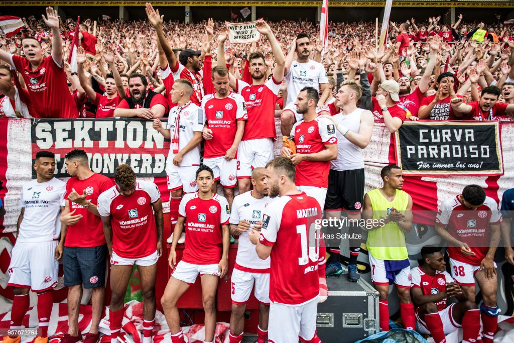 Fans and players of Mainz celebrate after the Bundesliga match between 1. FSV Mainz 05 and SV Werder Bremen at Opel Arena on May 12, 2018 in Mainz, Germany.