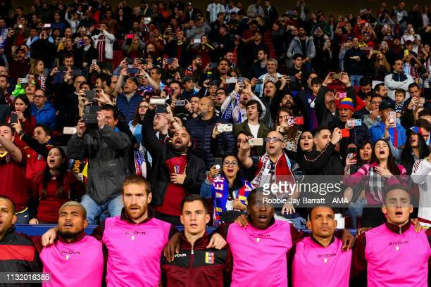 Fans and players of Venezuela sing the national anthem during the International Friendly match between Argentina and Venezuela at Estadio Wanda...