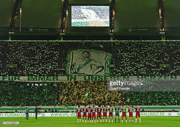 Fans and players remember former Wolfsburg player Junior Malanda recently died in a car crash prior to the Bundesliga match between VfL Wolfsburg and...