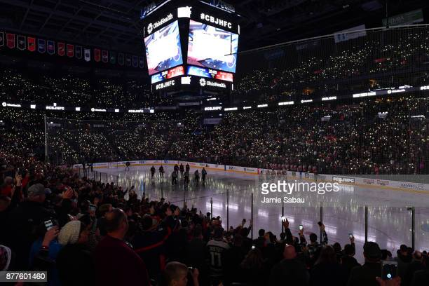 Fans and players stand for a moment of silence in honor of Hockey Fights Cancer prior to the start of a game between the Columbus Blue Jackets and...