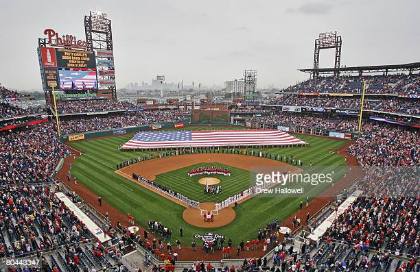Fans and players stand for the national anthem before the game between the Philadelphia Phillies and Washington Nationals on Opening Day March 31...