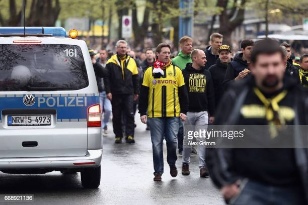 Fans and police in front of the stadium prior to the Bundesliga match between Borussia Dortmund and Eintracht Frankfurt at Signal Iduna Park on April...