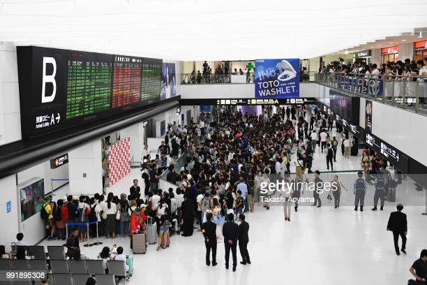 Fans and press wait for the Japan national team in the arrivals hall at Narita International Airport on July 5 2018 in Narita Narita Japan